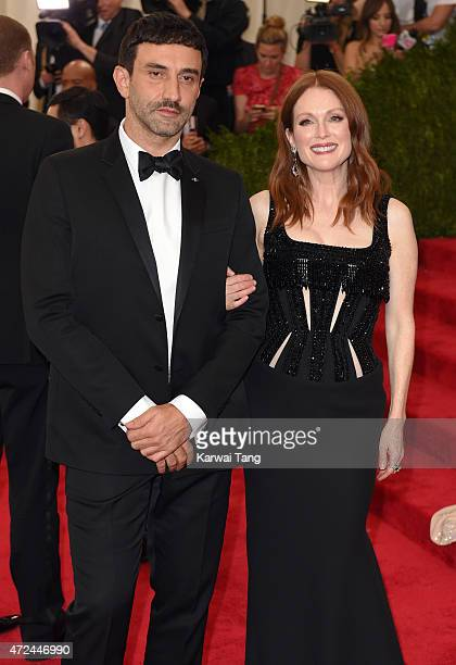 Riccardo Tisci and Julianne Moore attend the 'China Through The Looking Glass' Costume Institute Benefit Gala at Metropolitan Museum of Art on May 4...