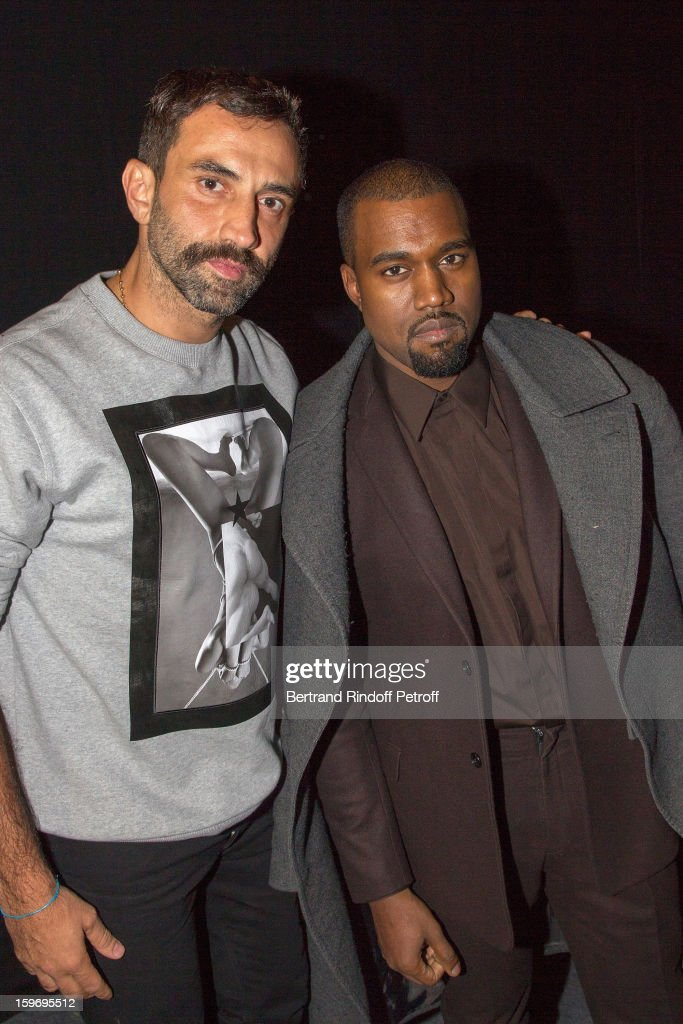 <a gi-track='captionPersonalityLinkClicked' href=/galleries/search?phrase=Riccardo+Tisci&family=editorial&specificpeople=2214975 ng-click='$event.stopPropagation()'>Riccardo Tisci</a> (L) and <a gi-track='captionPersonalityLinkClicked' href=/galleries/search?phrase=Kanye+West+-+Musiker&family=editorial&specificpeople=201803 ng-click='$event.stopPropagation()'>Kanye West</a> attend the Givenchy Men Autumn / Winter 2013 show as part of Paris Fashion Week on January 18, 2013 in Paris, France.