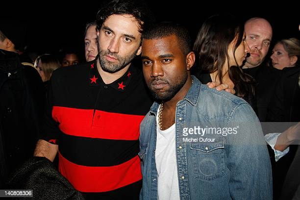 Riccardo Tisci and Kanye West attend the Kanye West aftershow as part of Paris Fashion Week at Halle Freyssinet on March 6 2012 in Paris France