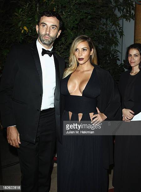 Riccardo Tisci and Kim Kardashian attend the 'Mademoiselle C' cocktail party at Pavillon Ledoyen on October 1 2013 in Paris France