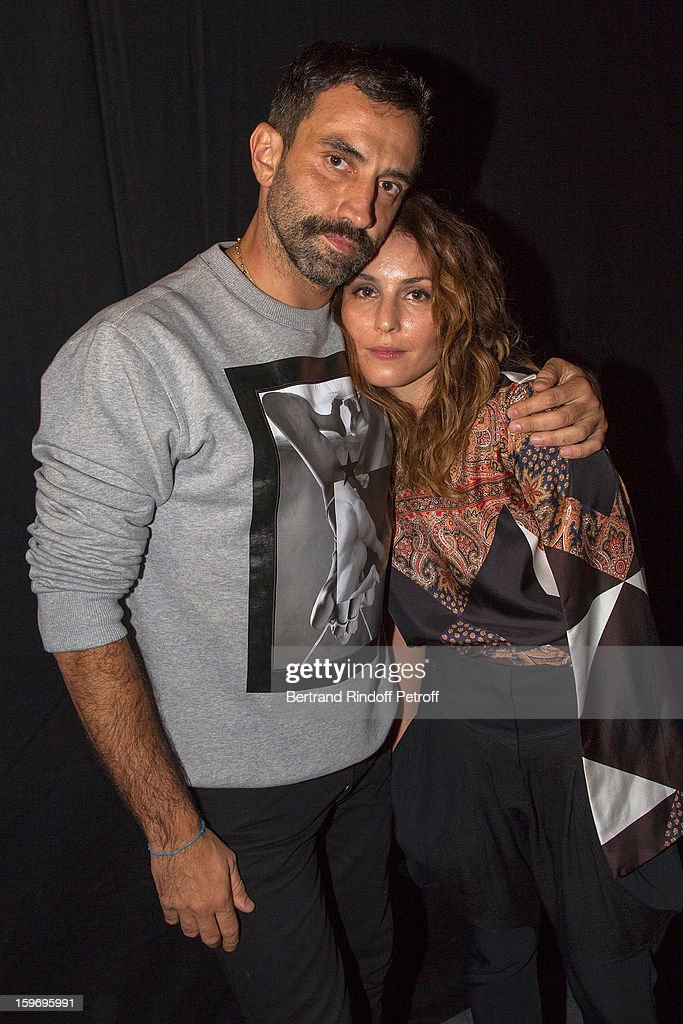Riccardo Tisci (L) and Noomi Rapace attend the Givenchy Men Autumn / Winter 2013 show as part of Paris Fashion Week on January 18, 2013 in Paris, France.
