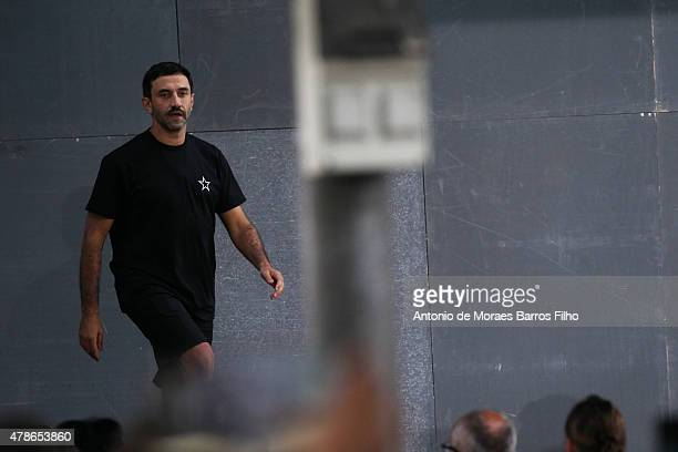 Riccardo Tisci walks the runway during the Givenchy Menswear Spring/Summer 2016 show as part of Paris Fashion Week on June 26 2015 in Paris France