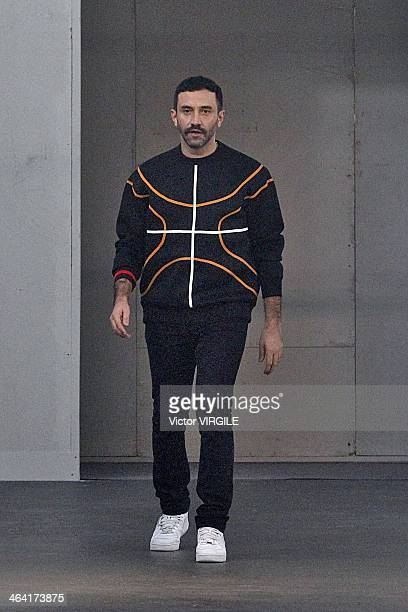 Riccardo Tisci walks the runway during the Givenchy Menswear Ready to Wear Fall/Winter 20142015 show as part of Paris Fashion Week on January 17 2014...