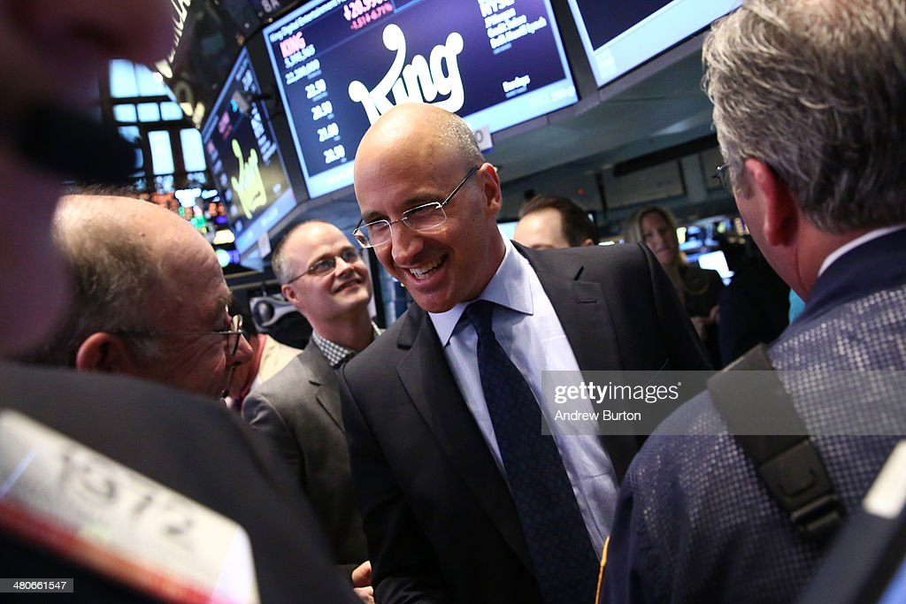 Riccardo Zacconi, CEO of King Digital Entertainment celebrates with traders on the floor of the New York Stock Exchange (NYSE), moments after King held its initial public offering at the NYSE on March 26, 2014 in New York City. King is the maker of the popular mobile game Candy Crush.