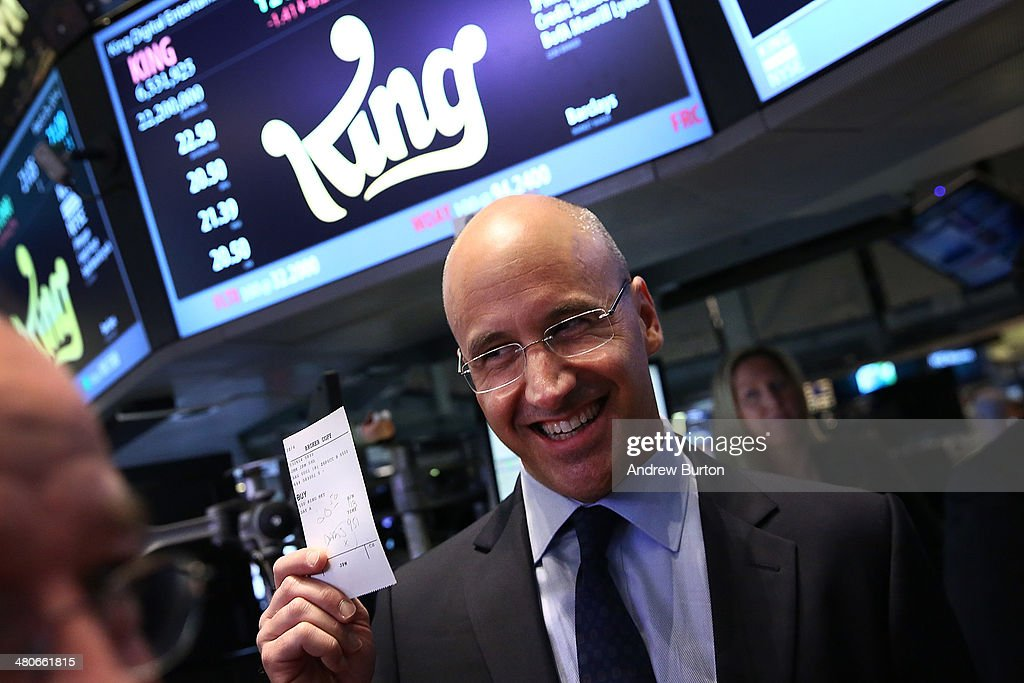 Riccardo Zacconi, CEO of King, holds up a ticket representing King's first trade after their initial public offering at the New York Stock Exchange (NYSE) on March 25, 2014 in New York, United States. King is the maker of the popular mobile game Candy Crush.