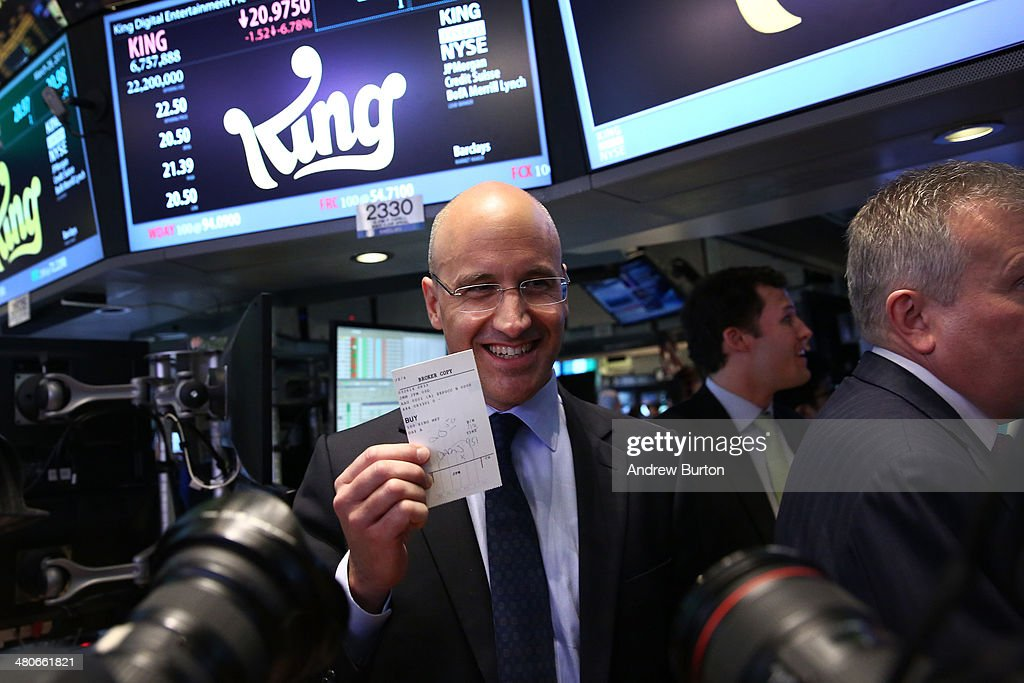 Riccardo Zacconi, CEO of King, holds up a ticket representing King's first trade after their initial public offering at the New York Stock Exchange (NYSE) on March 26, 2014 in New York City. King is the maker of the popular mobile game Candy Crush.