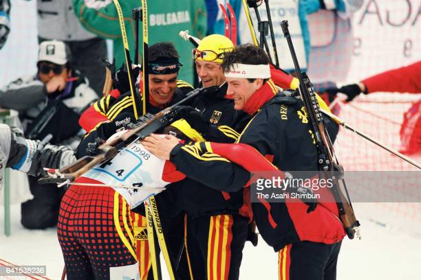 Ricco Gross Peter Sendel Sven Fischer and Frank Luck of Germany celebrate winning the gold medals in the Biathlon Men's 4x75km Relay during day...