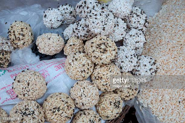 Rice balls covered in flies for sale at market