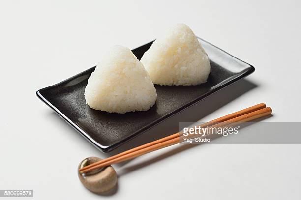 Rice balls with chopsticks