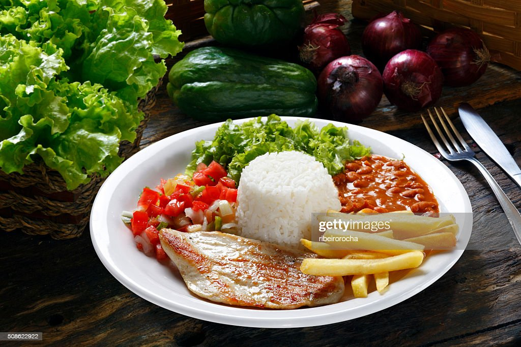 rice, beans, meat, chips and salad : Stock Photo