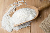Rice falling out from big wooden spoon