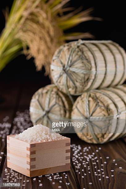 Rice in Measuring Cup and Rice Bale