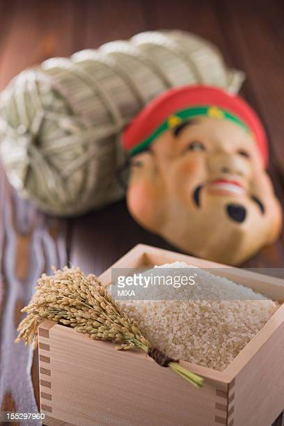Rice in Measuring Cup, Rice Bale and Mask of Daikokuten