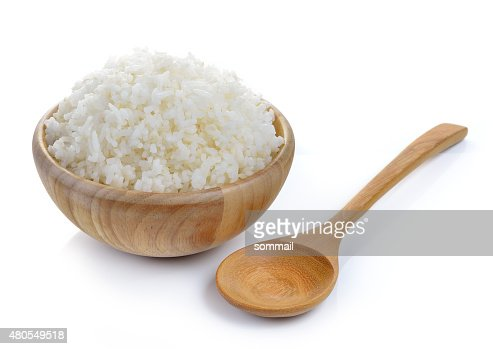 rice in wood bowl on white background : Stock Photo