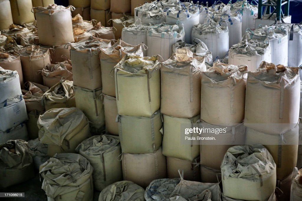 Rice is seen in a warehouse stored in giant bags at the Settapanich -Samchuk rice mill in on June 20, 2013 in Suphan Buri, Thailand. Thailand plans to sell as much as 7 million metric tons from inventories in order to fund a grain purchase program. Recently financial sources revealed that the actual losses from the government's controversial rice pledging scheme for the 2011-12 rice harvest year are close to reaching 200 billion baht [US$6.5 billion], this is far above the Thai Finance Ministryâs earlier forecast of 70-100 billion baht.