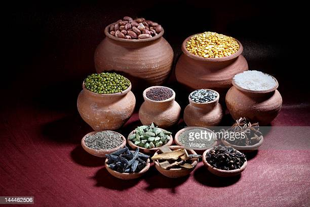 Rice, nuts, spices and pulses in earthen pots