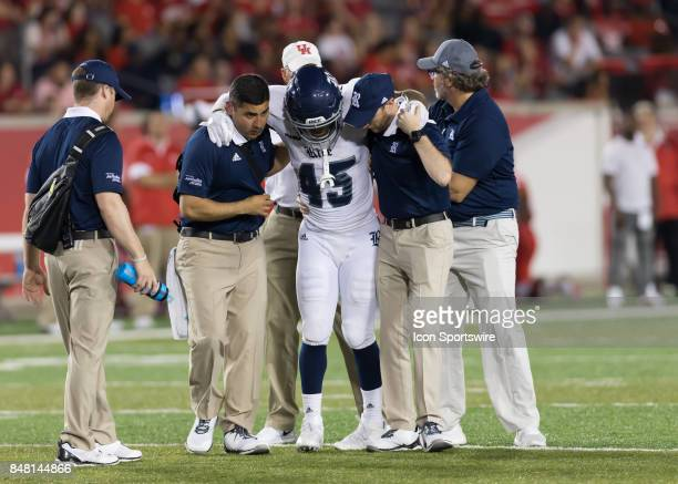 Rice Owls running back Samuel Stewart leaves the field with an injury during the football game between the Rice Owls and Houston Cougars on September...