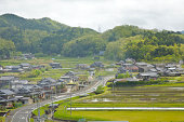 Rice paddies, traditional homes and verdant hills