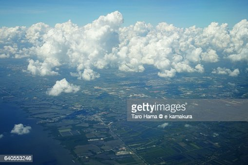 Rice paddy and sea in Bangkok aerial view from airplane