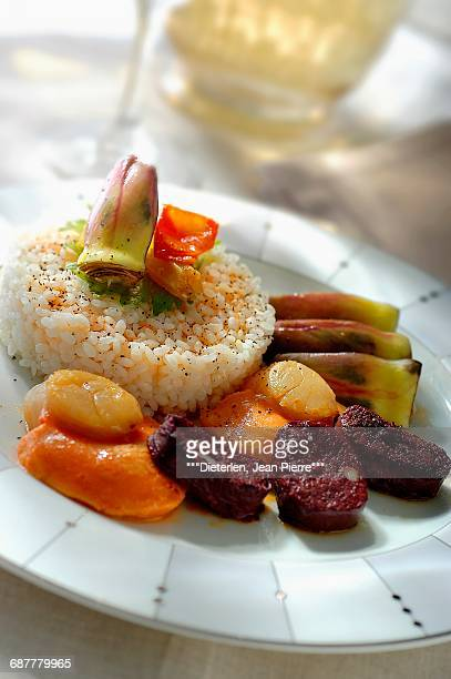 Rice with blood sausage and scallops