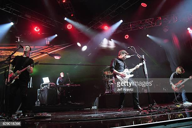 Rich Burch Jim Adkins and Tom Linton far left of the band Jimmy Eat World perform onstage at 1067 KROQ Almost Acoustic Christmas 2016 Night 1 at The...