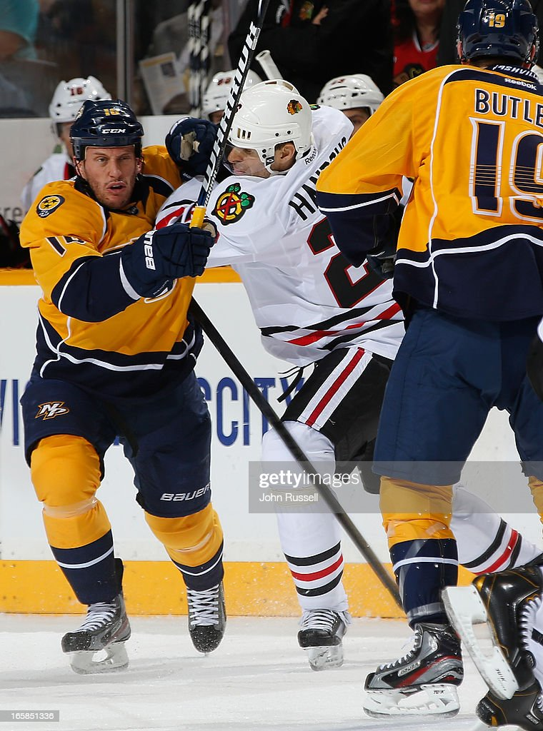 Rich Clune #16 of the Nashville Predators battles against Michal Handzus #26 of the Chicago Blackhawks during an NHL game at the Bridgestone Arena on April 6, 2013 in Nashville, Tennessee.
