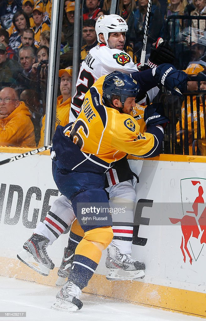 Rich Clune #16 of the Nashville Predators checks <a gi-track='captionPersonalityLinkClicked' href=/galleries/search?phrase=Michal+Rozsival&family=editorial&specificpeople=216462 ng-click='$event.stopPropagation()'>Michal Rozsival</a> #32 of the Chicago Blackhawks during an NHL game at the Bridgestone Arena on February 10, 2013 in Nashville, Tennessee.