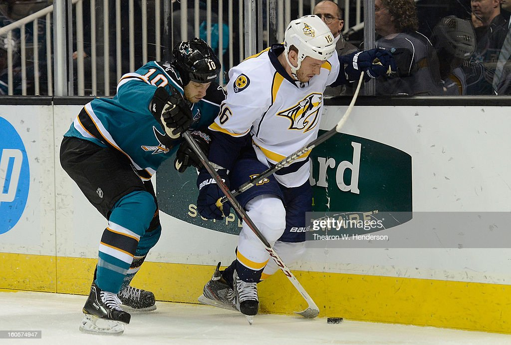Rich Clune #16 of the Nashville Predators fights for control of the puck with <a gi-track='captionPersonalityLinkClicked' href=/galleries/search?phrase=Andrew+Desjardins&family=editorial&specificpeople=2748431 ng-click='$event.stopPropagation()'>Andrew Desjardins</a> #10 of the San Jose Sharks in the first period of their game at HP Pavilion on February 2, 2013 in San Jose, California. The Predators won the game in an overtime shoot-out 2-1.