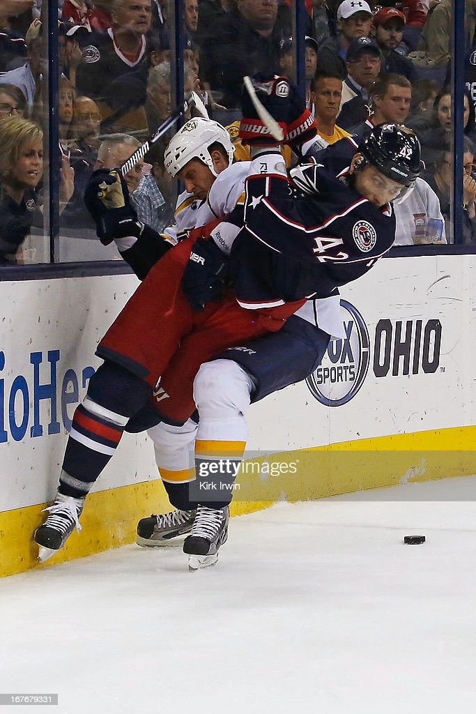 Rich Clune #16 of the Nashville Predators throws Artem Ansimov #42 of the Columbus Blue Jackets to the ice while battling for a loose puck during the second period on April 27, 2013 at Nationwide Arena in Columbus, Ohio.