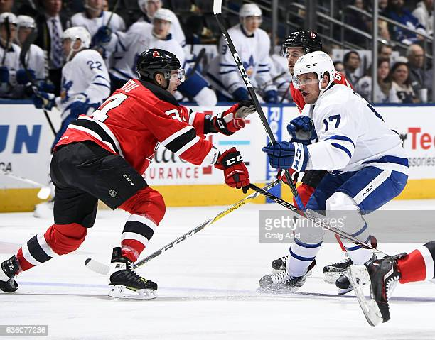 Rich Clune of the Toronto Marlies battles with Yohann Auvitu of the Albany Devils during AHL game action on December 17 2016 at Air Canada Centre in...