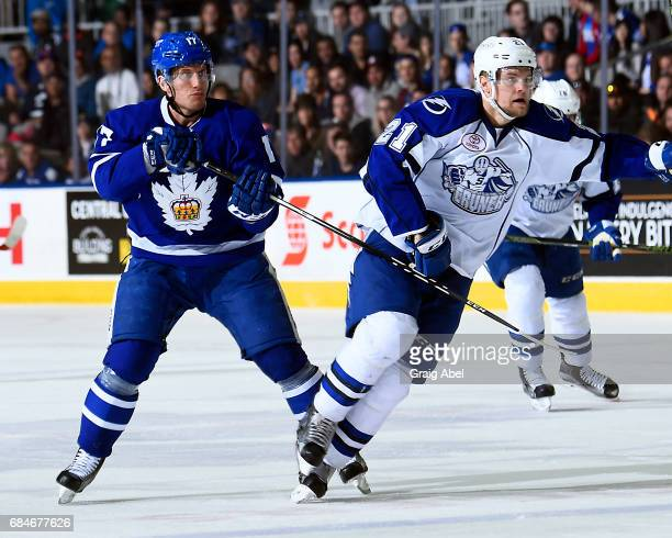 Rich Clune of the Toronto Marlies puts a hook on Byron Froese of the Syracuse Crunch during game 6 action in the Division Final of the Calder Cup...