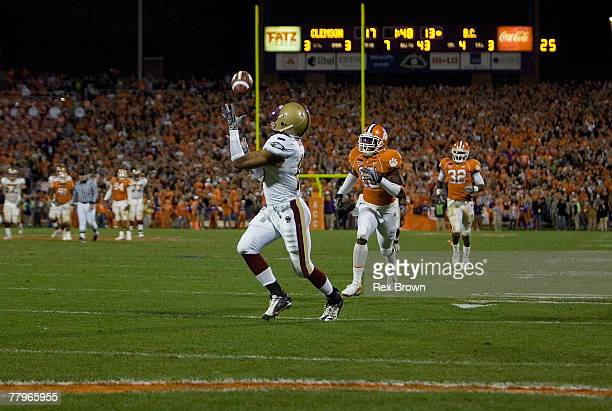 Rich Gunnell of the Boston College Eagles pulls in this 43 yard touchdown pass to win the game against the Clemson Tigers at Memorial Stadium...
