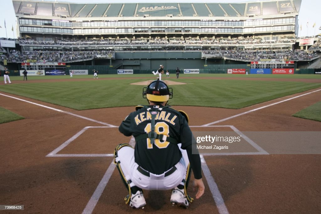 Rich Harden of the Oakland Athletics warms up with Jason Kendall during the game against the Chicago White Sox on MLB Opening Night at the McAfee Coliseum in Oakland, California on April 9, 2007. The White Sox defeated the Athletics 4-1.
