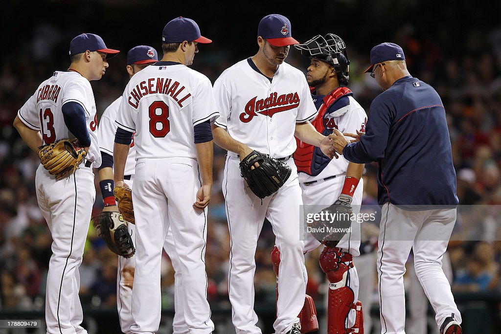 Rich Hill #53 of the Cleveland Indians is releived by manager Manager Terry Francona #17 as Asdrubal Cabrera #13, Lonnie Chisenhall #8, and Carlos Santana #41 meet at the mound against the Minnesota Twins during the seventh inning of their game on August 23, 2013 at Progressive Field in Cleveland, Ohio. The Twins defeated the Indians 5-1.