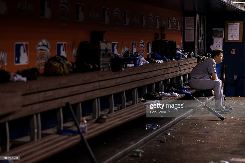 Rich Hill #44 of the Los Angeles Dodgers looks on from the dugout after being pulled during the eighth inning despite pitching seven perfect innings during the game against the Miami Marlins at Marlins Park on September 10, 2016 in Miami, Florida.