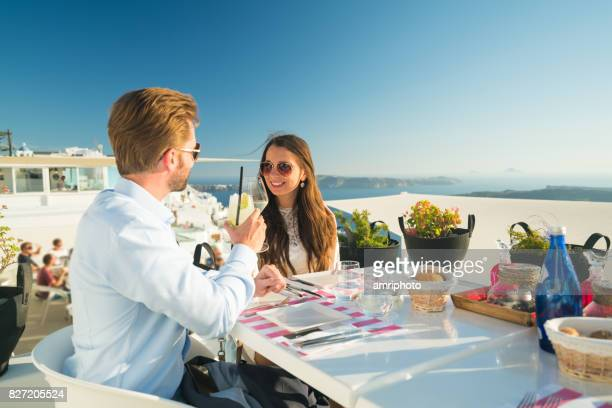 rich honeymoon couple on porch outside of restaurant