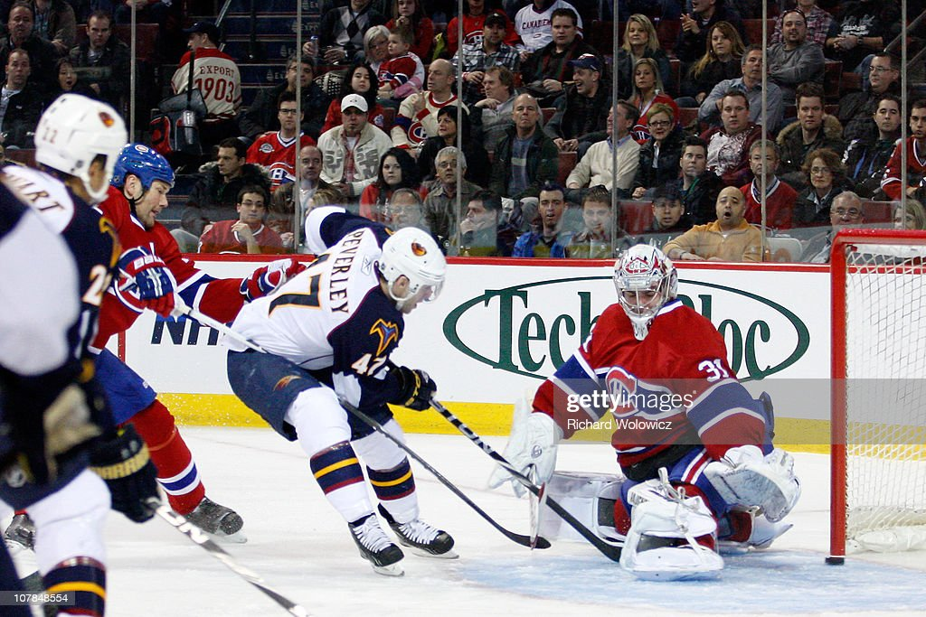 <a gi-track='captionPersonalityLinkClicked' href=/galleries/search?phrase=Rich+Peverley&family=editorial&specificpeople=554442 ng-click='$event.stopPropagation()'>Rich Peverley</a> #47 of the Atlanta Thrashers scores a first period goal on <a gi-track='captionPersonalityLinkClicked' href=/galleries/search?phrase=Carey+Price&family=editorial&specificpeople=2222083 ng-click='$event.stopPropagation()'>Carey Price</a> #31 of the Montreal Canadiens during the NHL game at the Bell Centre on January 2, 2011 in Montreal, Quebec, Canada. The Thrashers defeated the Canadiens 4-3 in overtime.