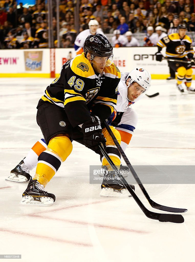 <a gi-track='captionPersonalityLinkClicked' href=/galleries/search?phrase=Rich+Peverley&family=editorial&specificpeople=554442 ng-click='$event.stopPropagation()'>Rich Peverley</a> #49 of the Boston Bruins carries the puck in front of defender against the New York Islanders during the game on January 25, 2013 at TD Garden in Boston, Massachusetts.