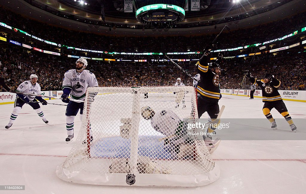 <a gi-track='captionPersonalityLinkClicked' href=/galleries/search?phrase=Rich+Peverley&family=editorial&specificpeople=554442 ng-click='$event.stopPropagation()'>Rich Peverley</a> #49 of the Boston Bruins celebrates after <a gi-track='captionPersonalityLinkClicked' href=/galleries/search?phrase=Mark+Recchi&family=editorial&specificpeople=202967 ng-click='$event.stopPropagation()'>Mark Recchi</a> #28 scored a goal in the second period against Roberto Luongo #1 of the Vancouver Canucks during Game Three of the 2011 NHL Stanley Cup Final at TD Garden on June 6, 2011 in Boston, Massachusetts.