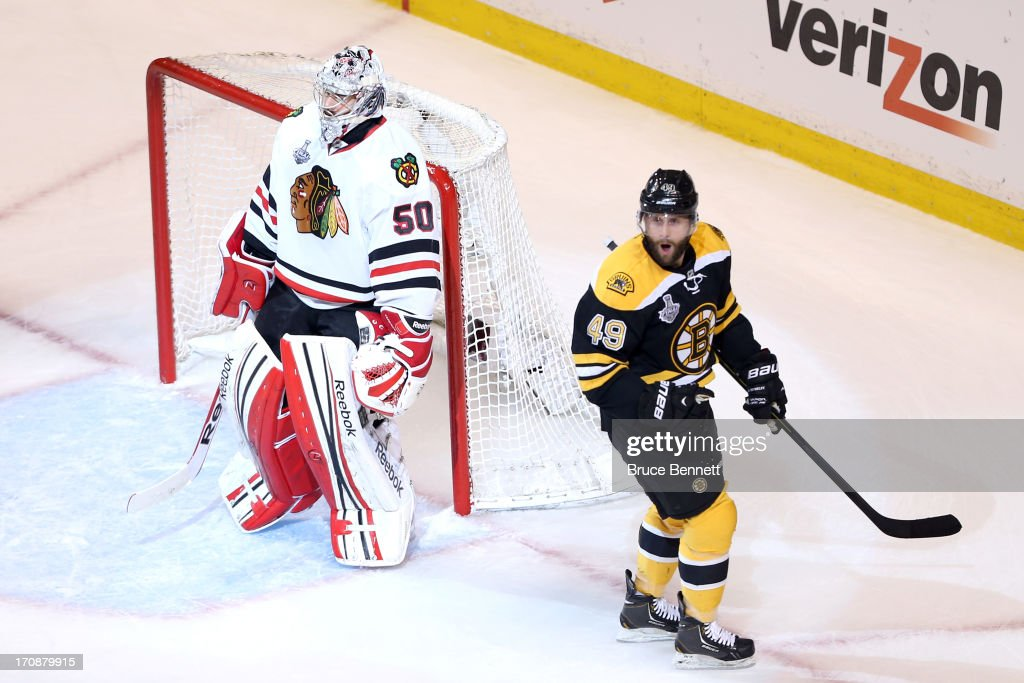 <a gi-track='captionPersonalityLinkClicked' href=/galleries/search?phrase=Rich+Peverley&family=editorial&specificpeople=554442 ng-click='$event.stopPropagation()'>Rich Peverley</a> #49 of the Boston Bruins celebrates after scoring a goal in the first period against <a gi-track='captionPersonalityLinkClicked' href=/galleries/search?phrase=Corey+Crawford&family=editorial&specificpeople=818935 ng-click='$event.stopPropagation()'>Corey Crawford</a> #50 of the Chicago Blackhawks in Game Four of the 2013 NHL Stanley Cup Final at TD Garden on June 19, 2013 in Boston, Massachusetts.