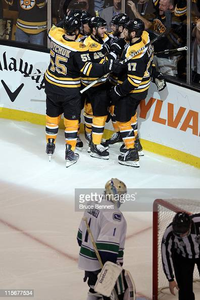 Rich Peverley of the Boston Bruins celebrates with his teammates Milan Lucic Johnny Boychuk David Krejci and Andrew Ference after scoring goal in the...