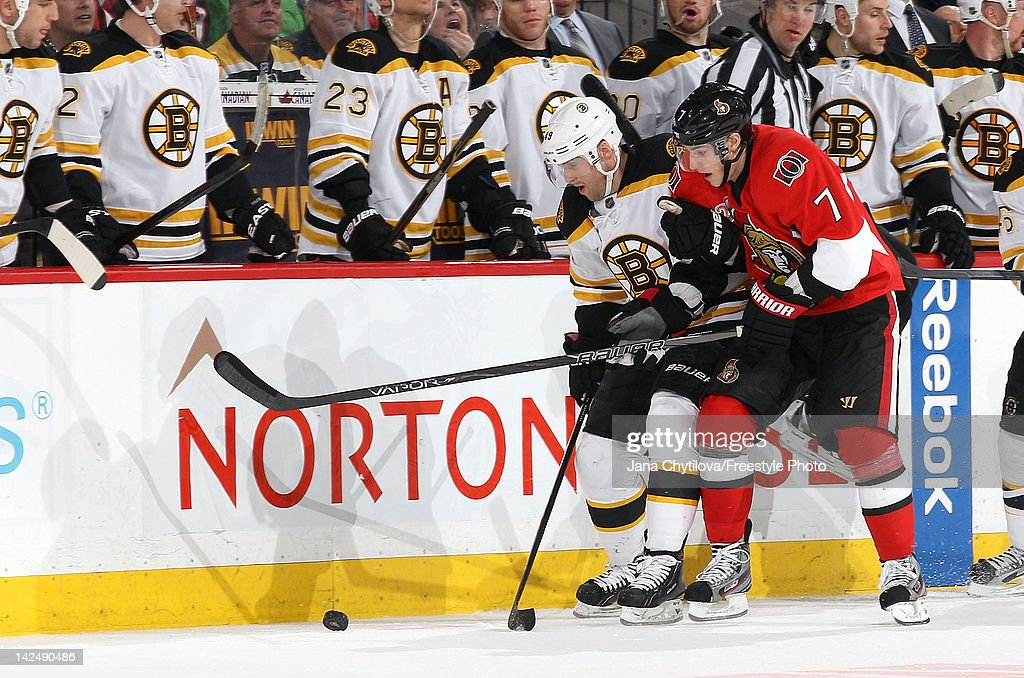 <a gi-track='captionPersonalityLinkClicked' href=/galleries/search?phrase=Rich+Peverley&family=editorial&specificpeople=554442 ng-click='$event.stopPropagation()'>Rich Peverley</a> #49 of the Boston Bruins holds the arm of <a gi-track='captionPersonalityLinkClicked' href=/galleries/search?phrase=Kyle+Turris&family=editorial&specificpeople=4251834 ng-click='$event.stopPropagation()'>Kyle Turris</a> #7 of the Ottawa Senators as they both battle for the loose puck during an NHL game at Scotiabank Place on April 5, 2012 in Ottawa, Ontario, Canada.