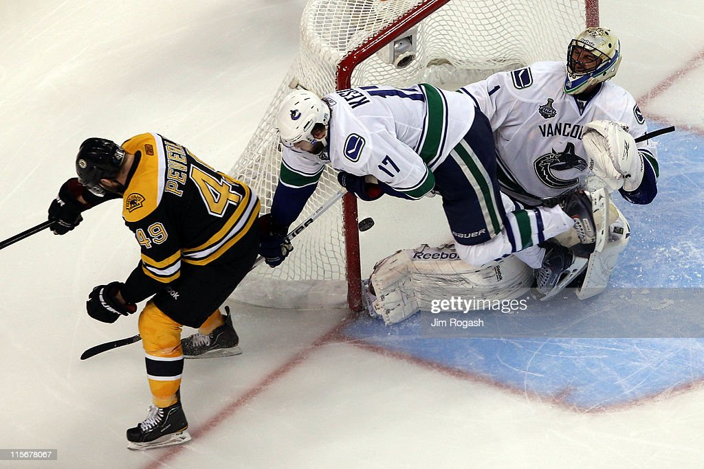 <a gi-track='captionPersonalityLinkClicked' href=/galleries/search?phrase=Rich+Peverley&family=editorial&specificpeople=554442 ng-click='$event.stopPropagation()'>Rich Peverley</a> #49 of the Boston Bruins scores a goal in the third period against <a gi-track='captionPersonalityLinkClicked' href=/galleries/search?phrase=Roberto+Luongo&family=editorial&specificpeople=202638 ng-click='$event.stopPropagation()'>Roberto Luongo</a> #1 of the Vancouver Canucks during Game Four of the 2011 NHL Stanley Cup Final at TD Garden on June 8, 2011 in Boston, Massachusetts.