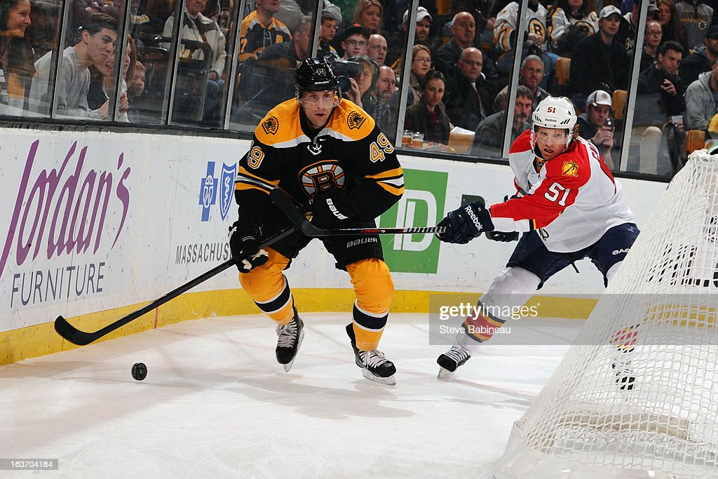 <a gi-track='captionPersonalityLinkClicked' href=/galleries/search?phrase=Rich+Peverley&family=editorial&specificpeople=554442 ng-click='$event.stopPropagation()'>Rich Peverley</a> #49 of the Boston Bruins skates against <a gi-track='captionPersonalityLinkClicked' href=/galleries/search?phrase=Brian+Campbell+-+Ice+Hockey+Player&family=editorial&specificpeople=209384 ng-click='$event.stopPropagation()'>Brian Campbell</a> #51 of the Florida Panthers at the TD Garden on March 14, 2013 in Boston, Massachusetts.