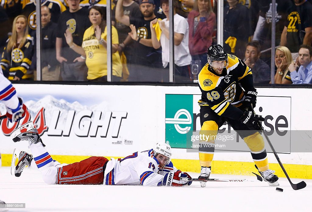 <a gi-track='captionPersonalityLinkClicked' href=/galleries/search?phrase=Rich+Peverley&family=editorial&specificpeople=554442 ng-click='$event.stopPropagation()'>Rich Peverley</a> #49 of the Boston Bruins skates with the puck past a fallen John Moore #17 of the New York Rangers in Game One of the Eastern Conference Semifinals during the 2013 NHL Stanley Cup Playoffs on May 16, 2013 at TD Garden in Boston, Massachusetts.