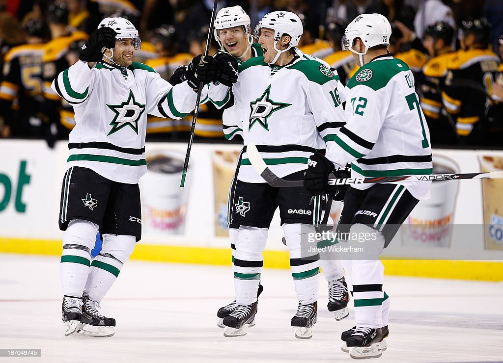 Rich Peverly #17 of the Dallas Stars is congratulated by teammates following his game-winning shootout goal against the Boston Bruins at TD Garden on November 5, 2013 in Boston, Massachusetts.