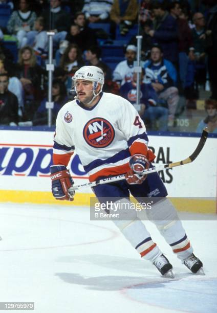 Rich Pilon of the New York Islanders skates on the ice during an NHL game in October 1992 at the Nassau Coliseum in Uniondale New York