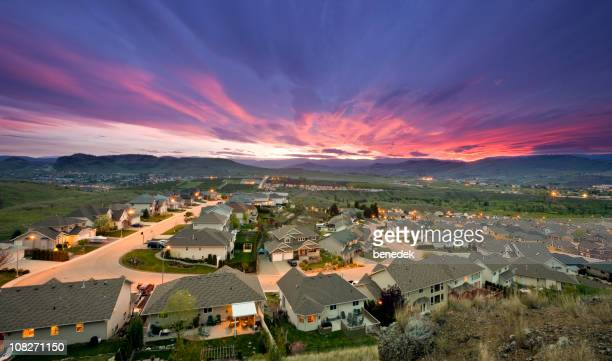 Rich suburb street and family homes urban sprawl
