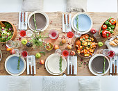Healthy food such as salad, vegetables, fruits on the served table