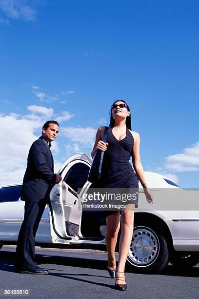 Rich woman leaving limousine